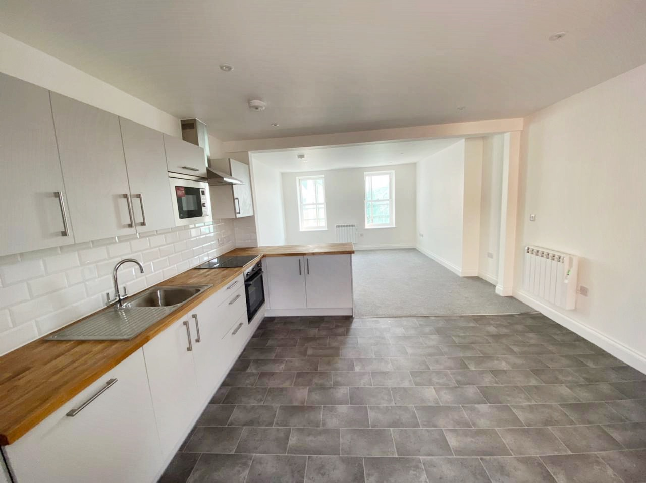 Brand New 2 Bedroom, 2 Shower Room, First Floor Apartment with Large Private Terrace Balcony